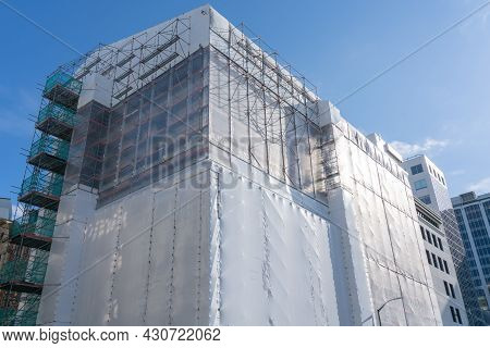 Wellington New Zealand - July 30 2021; Multi-story Building In Shrink-wrap To Protect Workers Inside