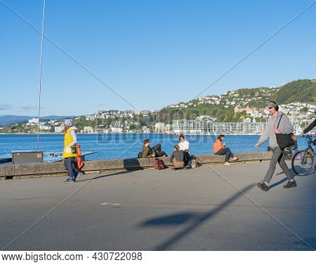 Wellington New Zealand - July 30 2021; People Enjoying, Relaxing And Commuting Along The Great Harbo