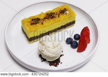 Mango Mousse Cake With Vanilla Ice Cream And Berries