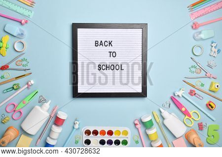 Flat Lay Office Supplies. Back To School. Various Office Supplies On A Light Blue Background With A