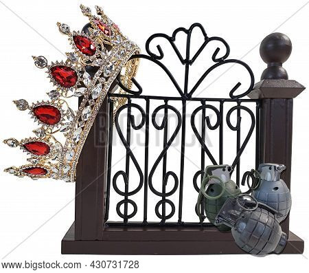 Grenade In Front Of A Fancy Gate With A Crown Showing Threats To Expensive Property Or High Powered