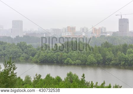 New Multi-storey Residential Buildings Of Modern Architecture In The Fog On The Banks Of The Ob Rive