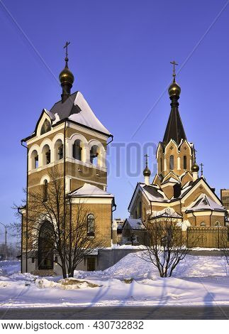 Church Of St. Andrew In The Area Of Springs. Morning Pink Light, Russian Style, Crosses On Golden Do