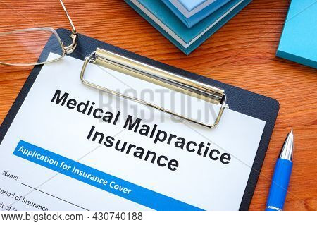 The Medical Malpractice Insurance Application And Clipboard.