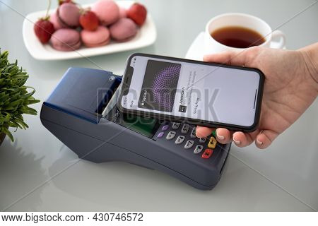 Alanya, Turkey - October 1 2019 : Waman Hand Holding Iphone 11 With Apple Pay Cash On The Screen And