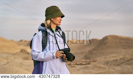 Asian Woman Photographer Walking In A National Geological Park Looking At View