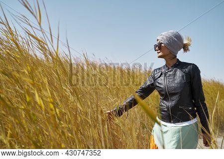 Asian Woman Female Tourist Walking In Reed Marsh