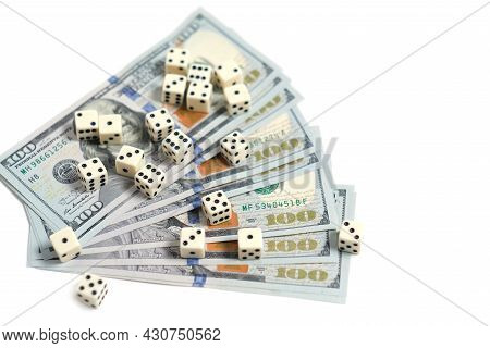 Playing Dice And A Stack Of Hundred-dollar Bills On A White Background. Gambling And Betting