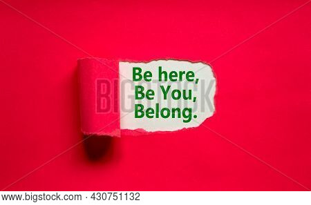 You Belong Here Symbol. Words 'be Here, Be You, Belong' Appearing Behind Torn Purple Paper. Purple B