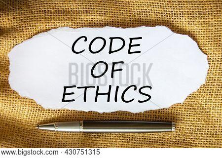 Code Of Ethics Symbol. Words 'code Of Ethics' On White Paper. Black Metallic Pen. Beautiful Canvas B