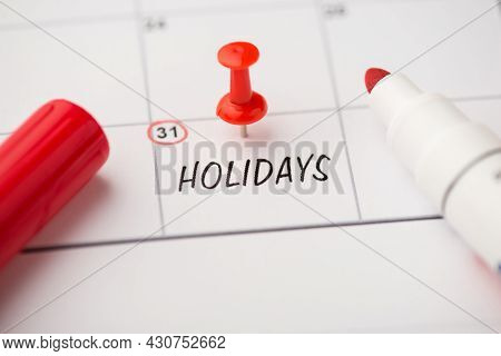 Closeup Photo Of Mark On Calendar At Thirty-first Inscription Holidays With Red Pushpin And Marker