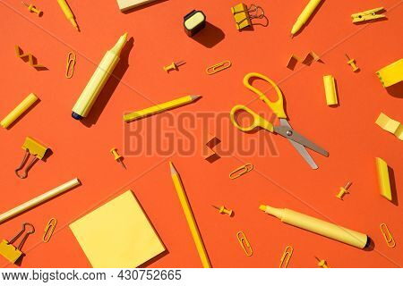 Top View Photo Of Scattered Yellow Stationery School Accessories Scissors Pencils Markers Binder Cli
