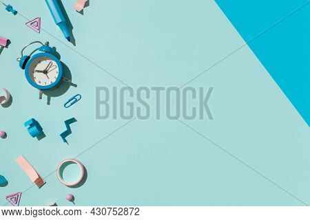 Top View Photo Of Bicolor Blue And Pink Stationery Marker Binder Clip Pushpins Adhesive Tape And Ala