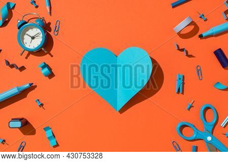 Top View Photo Of Blue Folded Paper Heart And Blue School Supplies Stationery Alarm Clock Markers Sc