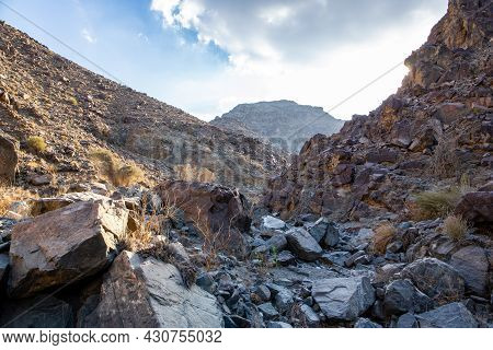 Stony, Dry Riverbed (wadi) With Remains Of Raw Ore Of Copper, Green Stones And Rocks, Copper Hike Tr