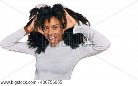 Young african american girl wearing casual clothes smiling cheerful playing peek a boo with hands showing face. surprised and exited