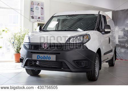 Russia, Izhevsk - August 20, 2021: Fiat Showroom. New Modern Doblo Cargo Van In Dealer Showroom. Fro