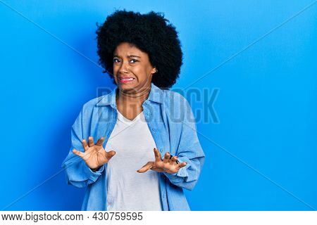Young african american woman wearing casual clothes disgusted expression, displeased and fearful doing disgust face because aversion reaction.