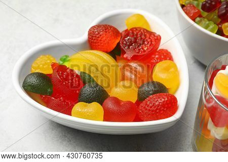 Delicious Fruity Gummy Candies On Light Grey Table, Closeup