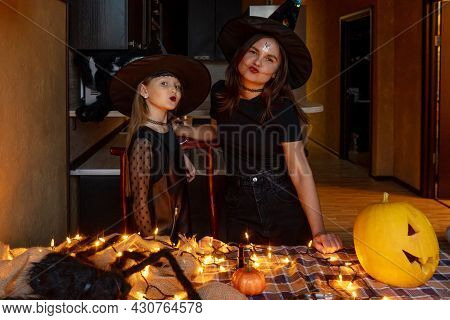 Mother And Daughter In Witch Costume. Halloween.
