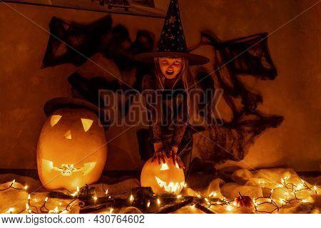 Girl In Witch Costume Celebrate Halloween. Dark