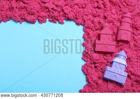 Pink Kinetic Sand And Toy On Light Blue Background, Flat Lay. Space For Text