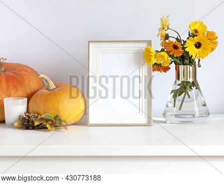 Seasonal Autumn Fall Decorations With Photo Frame, Colorful Calendula Flowers In A Vase And Pumpkins