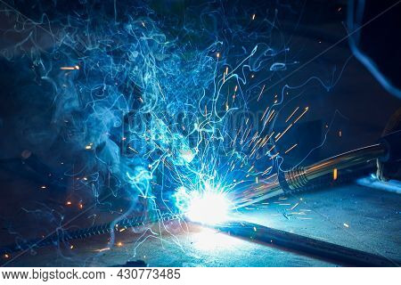 Metal Welding. Semi-automatic Welding Of Rods And Metal Structures In A Workshop At An Oil Refinery