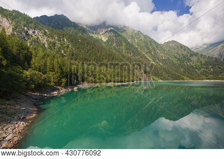 Enchanted View Of The Lago Dei Cavalli, Alpe Cheggio. The Clear Water, The Rich Vegetation, The Blue