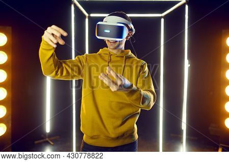 Gamer plays simulator in virtual reality headset