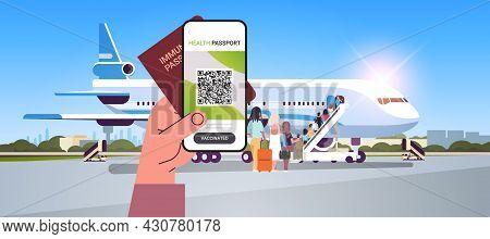 Hand Holding Digital Vaccinate Certificate And Global Immunity Passport Near Airplane Coronavirus Im