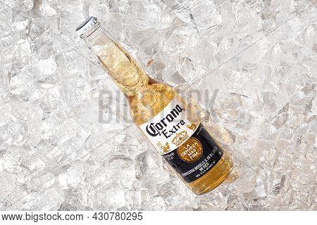 Tallinn, Estonia- April 12.2021: Corona Beer In Glass Bottle On Ice. Corona Extra Is Pale Lager Prod
