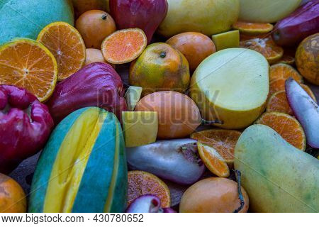 Variety Of Fresh Assorted Fruits On The Old Wooden Table. Assorted Fruits Colorful Background, Healt