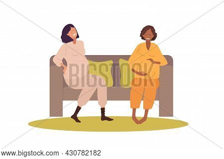 Two Pregnant Women Sitting On Sofa And Talking. Caucasian Sad Woman Complains To Friend About Pain,