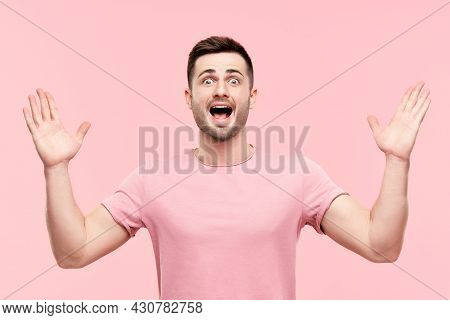 Surprised Excited Man Portrait With Arms Raised