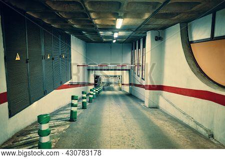 Entrance Gate In Underground Parking. Empty Garage