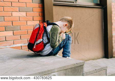 Back To School. Cute Child With Backpack, Holding Notepad And Training Books. School Boy Pupil With