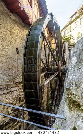 Water Mill In Meersburg, Germany. Vertical View Of Old Medieval Mill Wheel Near Houses. This Place I