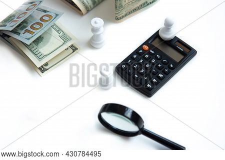 Magnifier, Calculator, Paper Money And White Chess Isolated On White Background