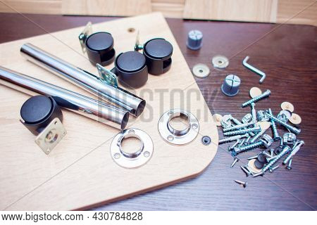 Fasteners For Collecting Furniture. A Set Of Fasteners For Assembling The Table. Screws And Furnitur