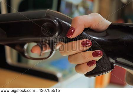 Woman Gamer Hand Playing Vintage Shooting Arcade Machine Game - Close Up, Selective Focus. Gaming, 8