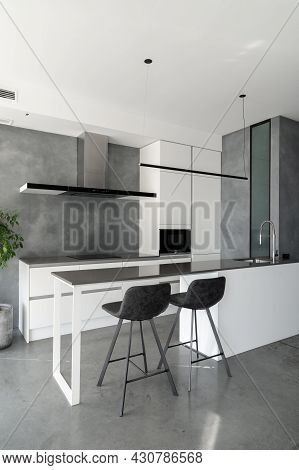 Spacious Kitchen With Minimalist Square Shaped Furniture, Grey Floor And Walls, Counter With Integra