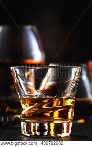 Strong Alcohol Drinks, Hard Liquors, Spirits And Distillates In Glasses: Cognac, Scotch, Whiskey And