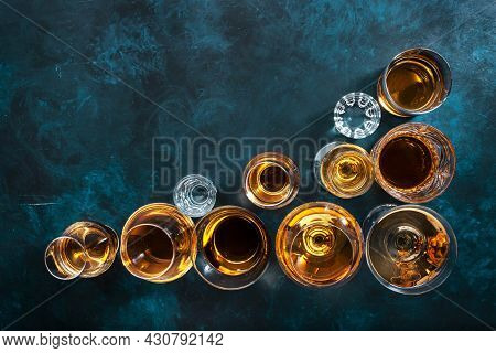 Strong Alcohol Drinks, Hard Liquors, Spirits And Distillates Set In Glasses: Cognac, Scotch, Whiskey