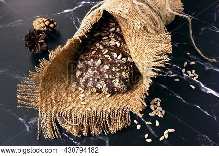 Rye bread baked with sesame seeds, linseeds and sunflower seeds.