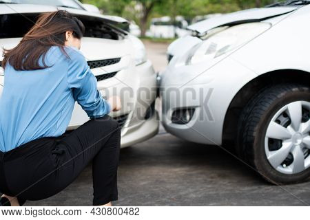Women Drivers Sad After A Car Accident Because Not Have Car Accident Insurance.