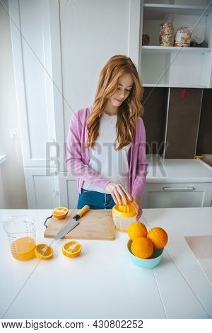 Fruit Juice. Woman Squeeze Fresh Juice. Ginger Person With Freckles Working In Kitchen.