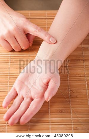 Acupressure, acupuncture. Finger on point called Intermediary Messenger JIANSHI P5. Presentation on how to find this point.