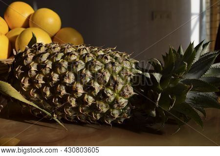 Pineapple Fruit. Sweet Delicious Fruits With Wooden Background. Side View Of Pineapple With Malta Or