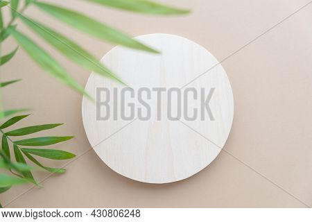 Abstract Minimal Scene Of A Geometrical Form. A Cylindrical Wooden Podium On A Beige Background With